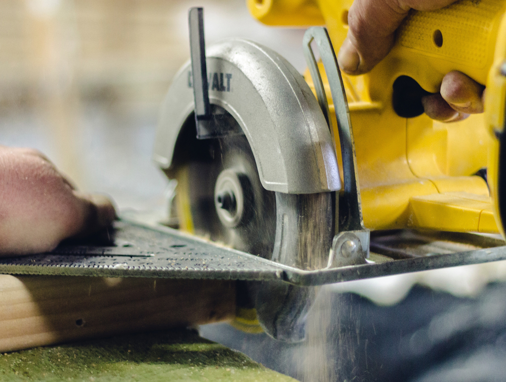 image showing a saw cutting a board